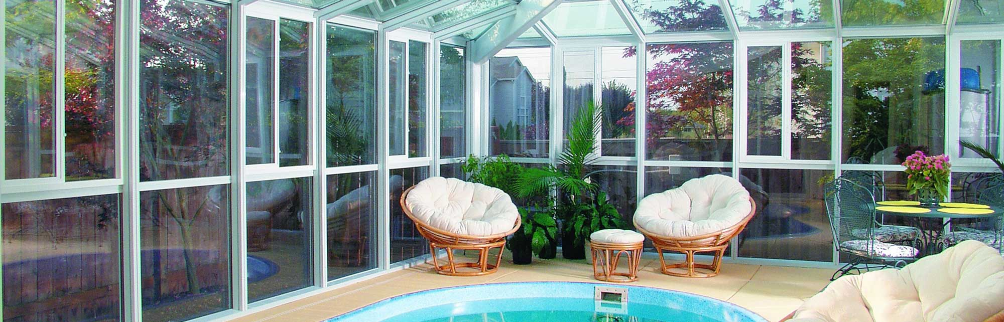 Pool enclosure with surrounding pool furniture